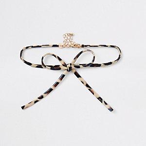 Collier ras-de-cou avec nœud imprimé léopard marron