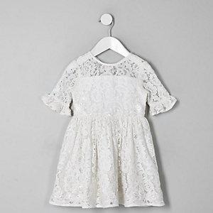 Robe en dentelle blanche nouée dans le dos pour mini fille