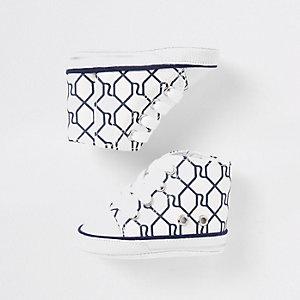 Marineblaue Stiefel mit RI-Monogramm
