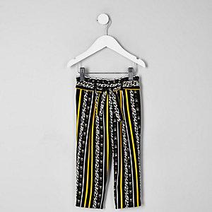 Mini girls black leopard stripe trousers