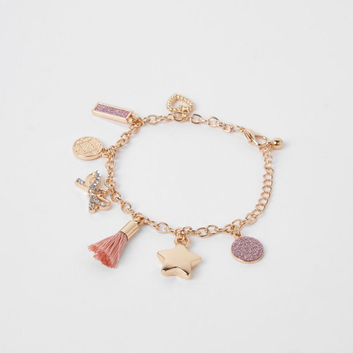 Girls gold tone pink tassel charm bracelet