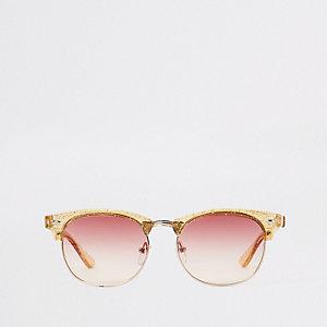 Goldene, glitzernde Retro-Sonnenbrille