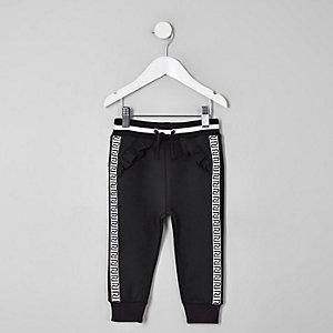 Mini - Zwarte joggingbroek met bies en RI-print voor meisjes
