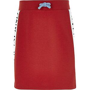Rode rok met bies met RI-logo voor meisjes