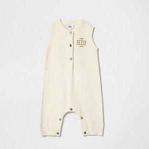 Crème gebreid rompertje met RI-logo voor baby's