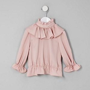 Roze hoogsluitende blouse met ruches voor meisjes