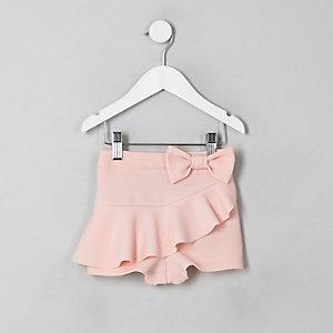 Jupe-short rose à volants avec nœud pour mini fille