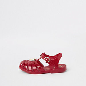 Sandales en plastique rouges effet cage mini fille