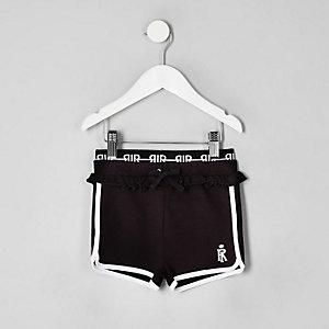 Mini girls black frill trim runner shorts