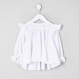 Top blanc à broderie anglaise et volants mini fille