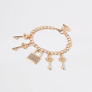 Girls gold tone chunky charm bracelet