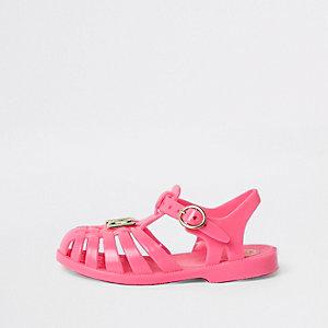 Sandales en plastique rose fluo effet cage pour mini fille