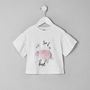 T-shirt motif licorne blanc à pompon mini fille