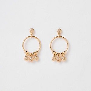 Girls gold tone shell hoop earrings