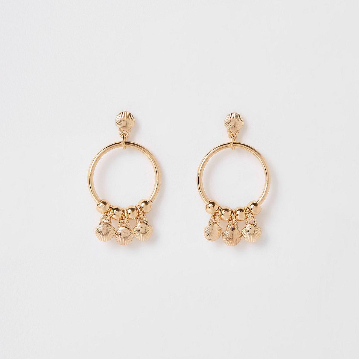 Girls gold tone shell hoop earrings
