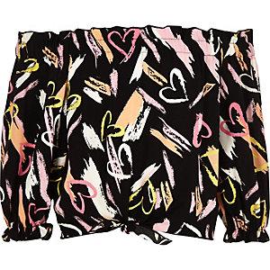 Zwarte bardottop met hartenprint en strik voor meisjes