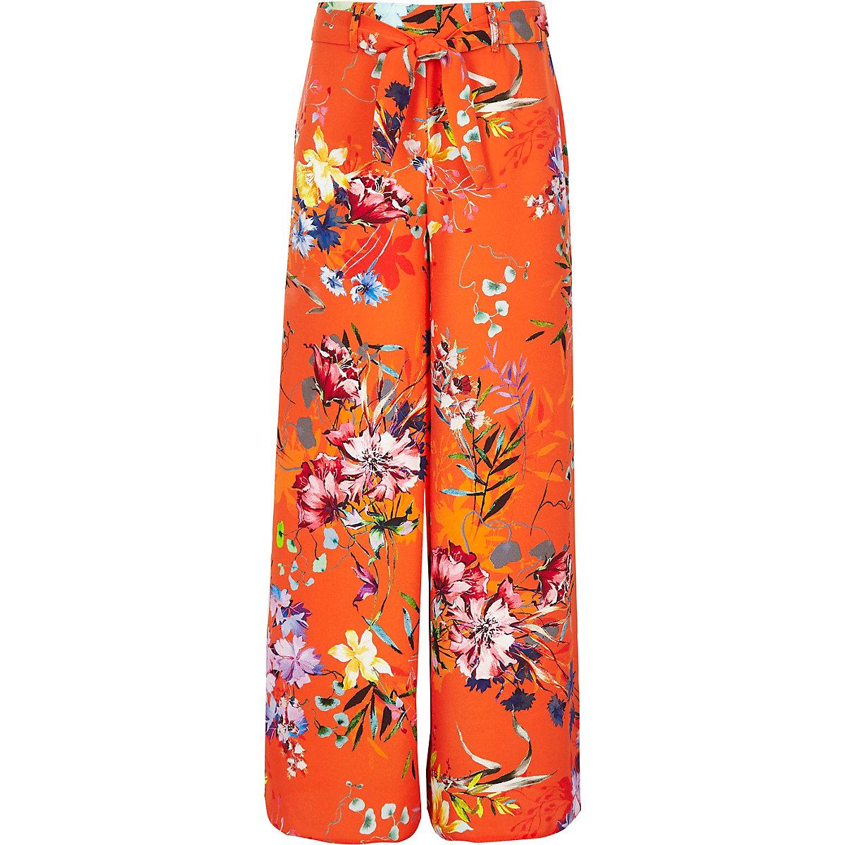 Girls orange floral wide leg trousers