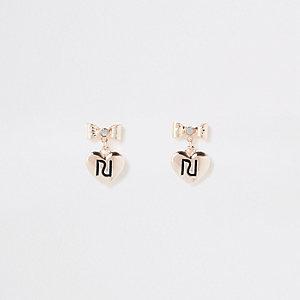 RI – Clous d'oreilles dorés avec nœud pour fille