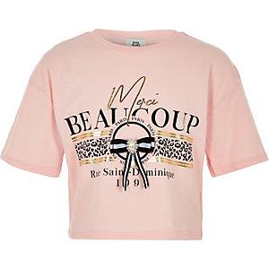 Roze T-shirt met 'Merci beaucoup'-print en strik voor meisjes