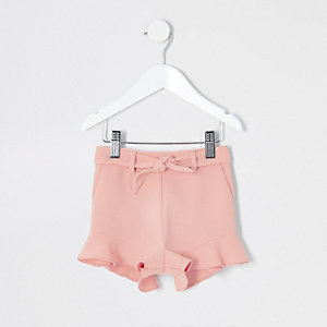 Short rose à volants mini fille