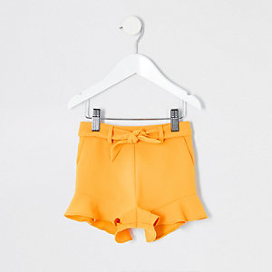 Short jaune à volants mini fille