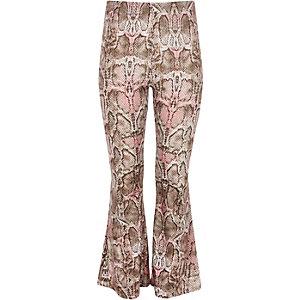 Roze uitlopende broek met slangenprint voor meisjes