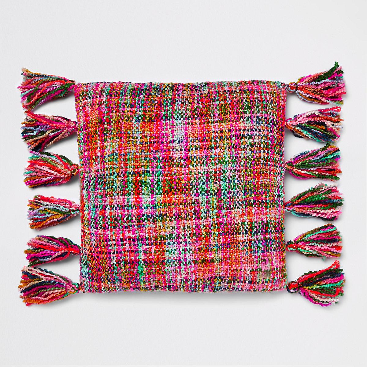 Coussin en maille multicolore à pampilles