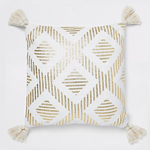 Gold print cushion with tassels