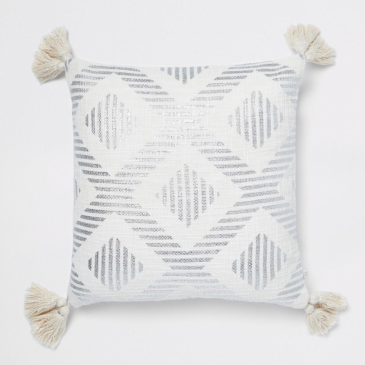 Silver print cushion with tassels
