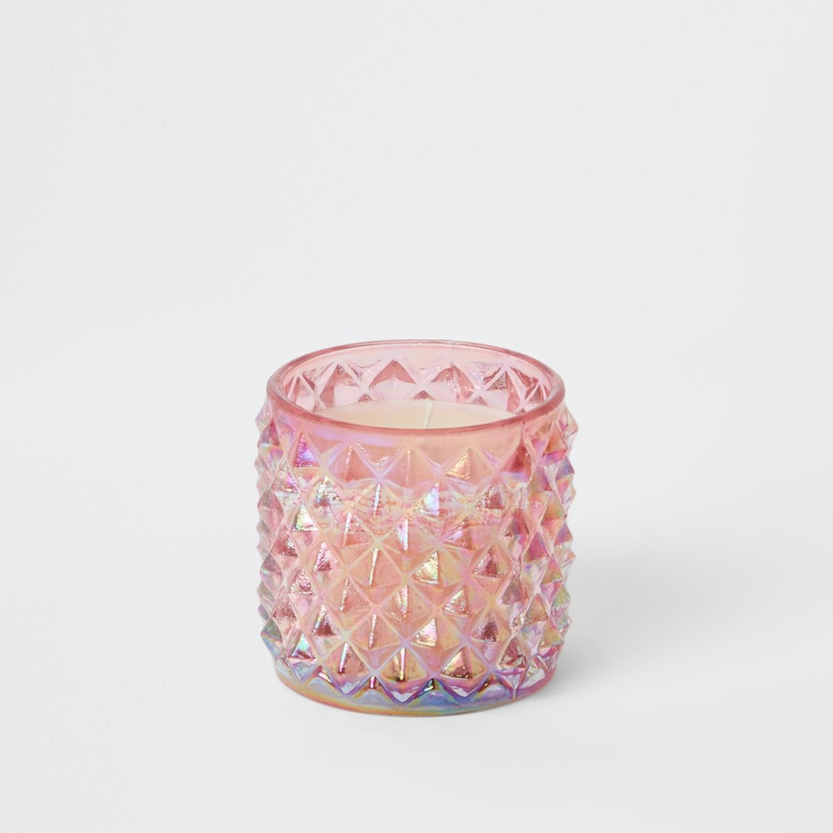 Pink wax filled glass candle