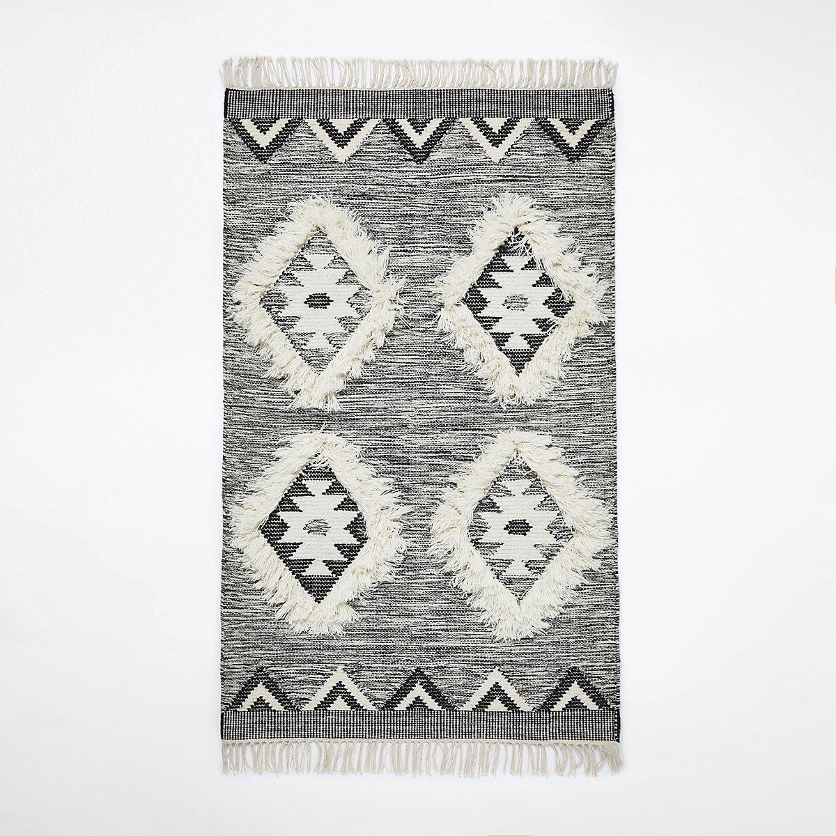 Petit tapis gris géométrique en losange