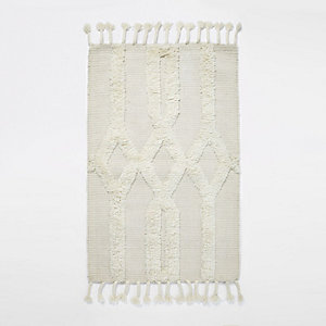 Cream tufted geometric rug