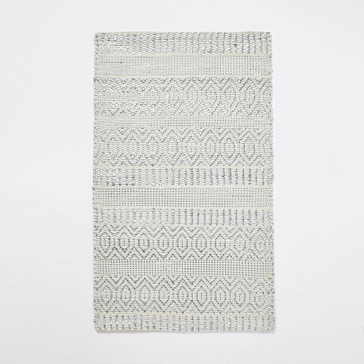 Cream geometric woven rug
