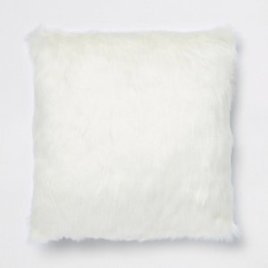Cream faux fur cushion with gold foil reverse