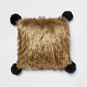 Brown faux fur cushion with black pom poms