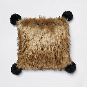 Brown faux fur cushion with black pom poms