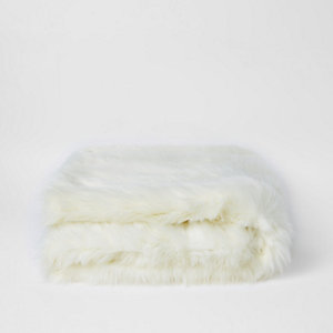 Cream faux fur throw with gold foil reverse