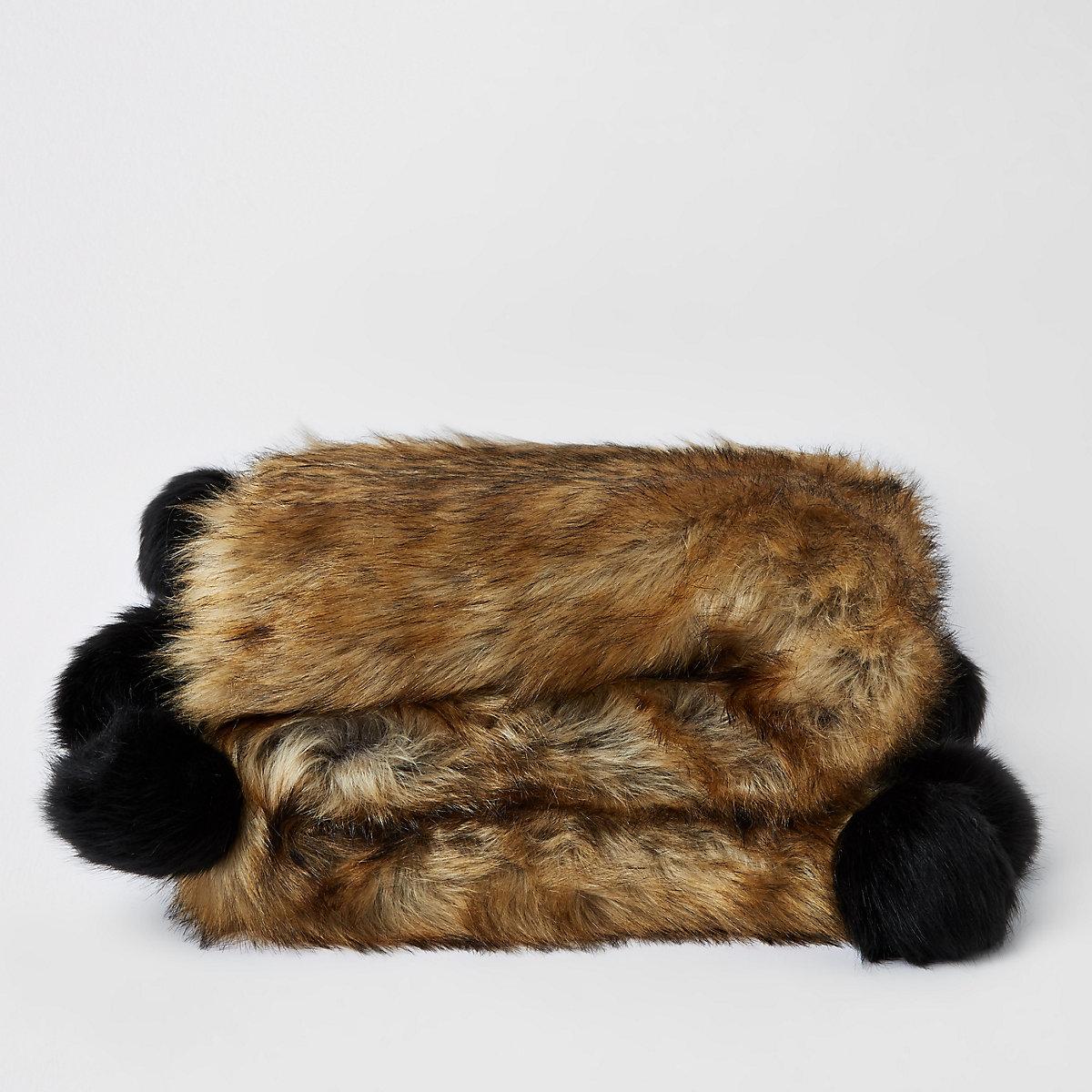 Brown faux fur throw with black pom pom