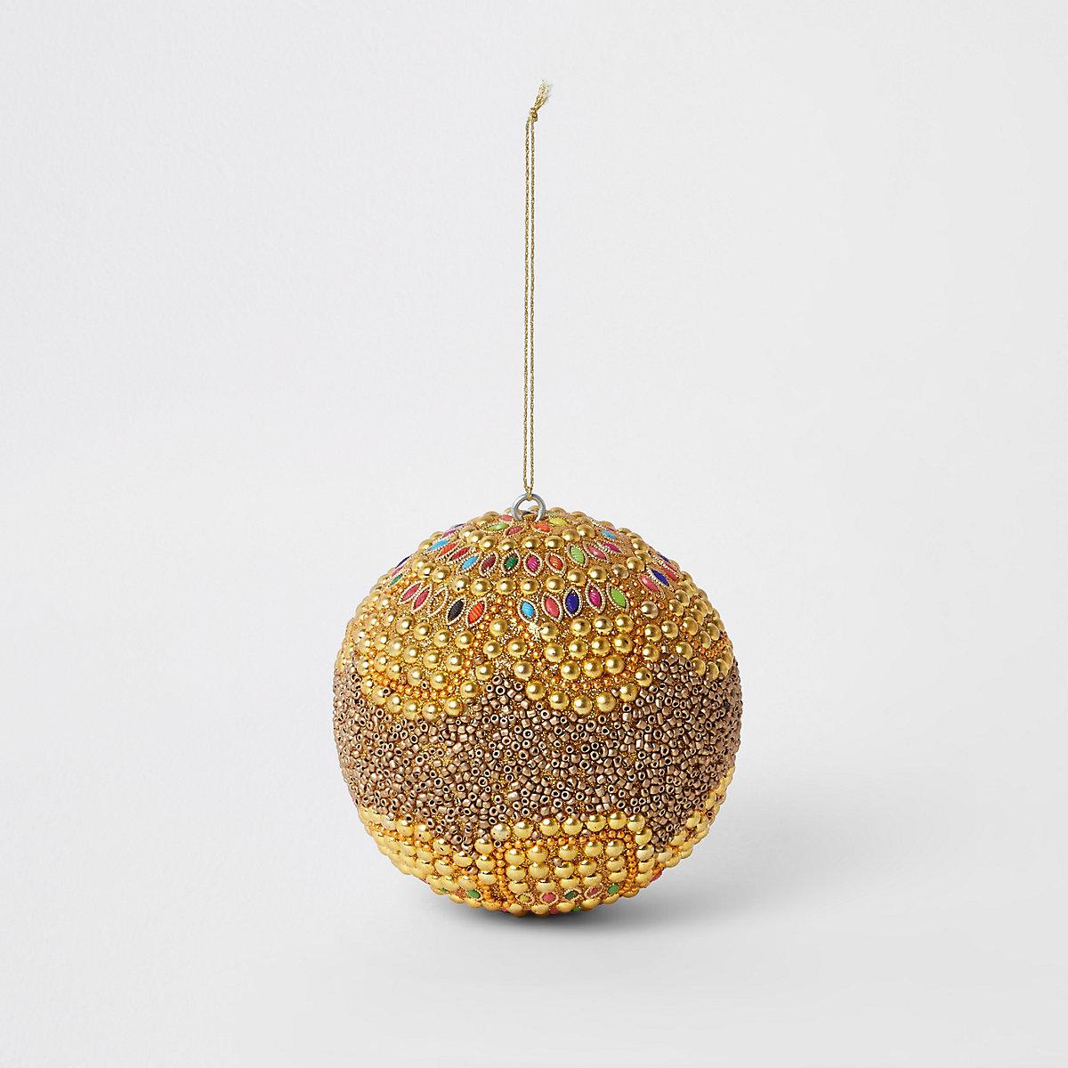 Boule de Noël dorée brillante ornée de perles