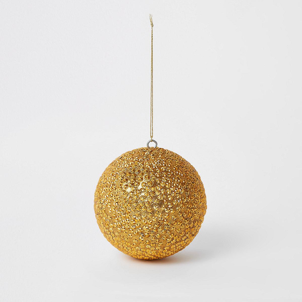 Grosse boule de Noël dorée brillante