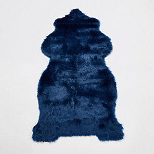 Blue faux fur rug with gold foil reverse