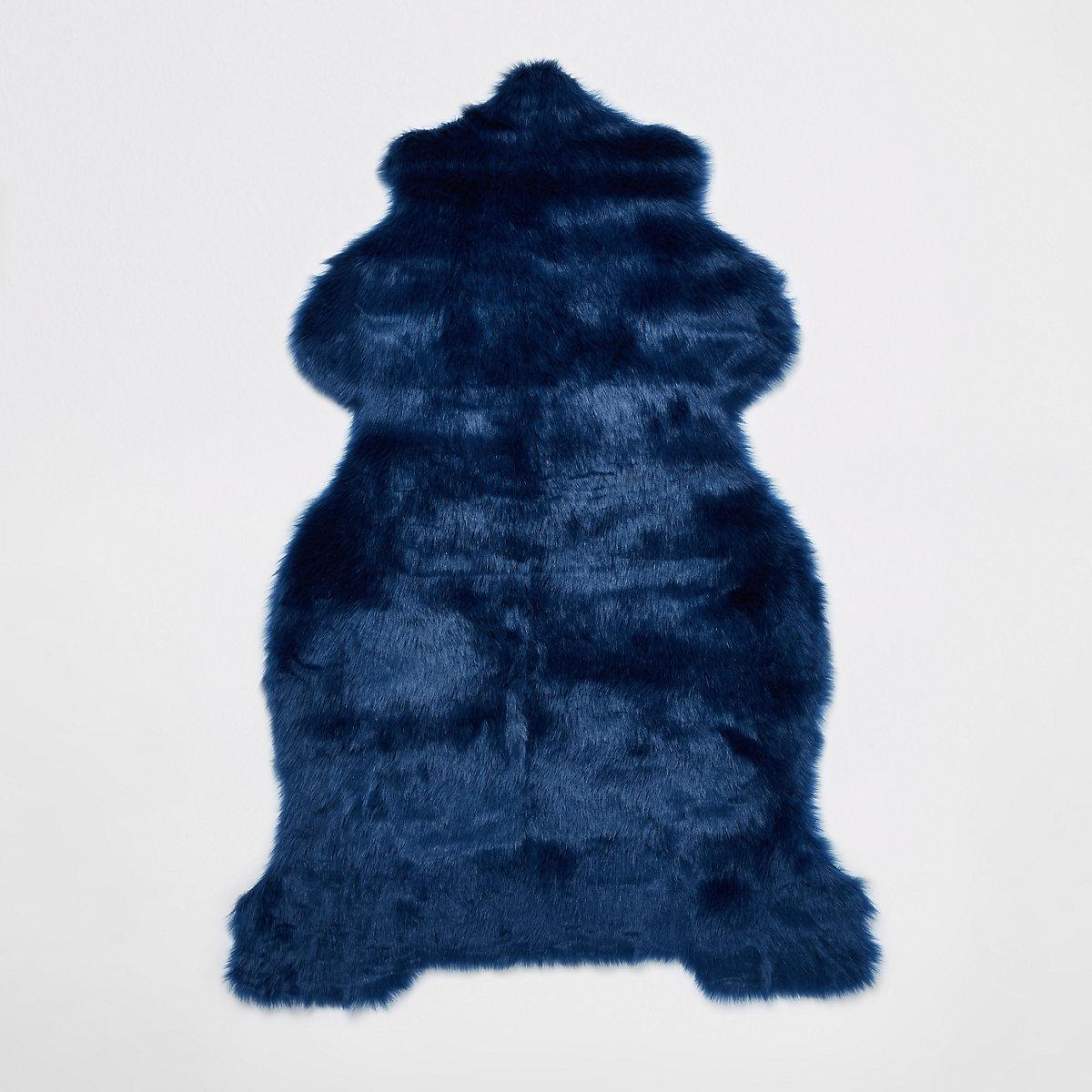 Blue faux fur rug with gold foil reverse
