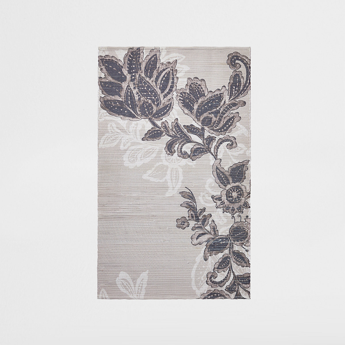 Petit tapis à fleurs gris