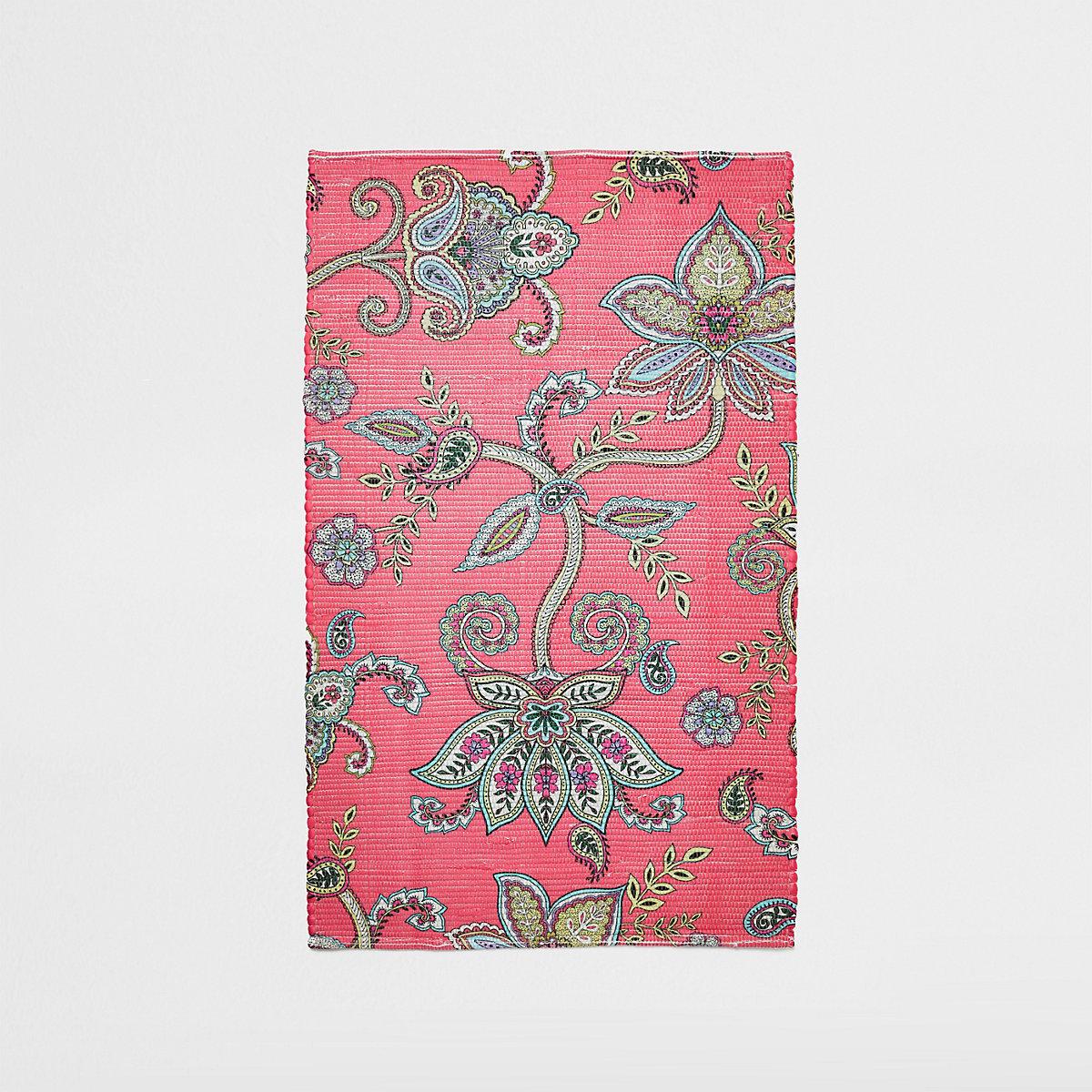 Small pink floral printed rug