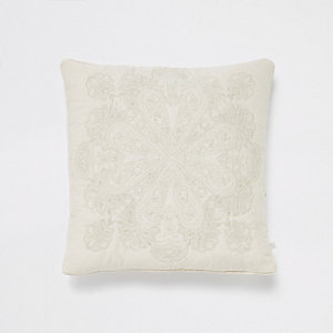 Cream and gold embroidered cushion