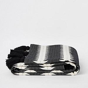 Couverture motif zigzag noire et blanche à pampilles