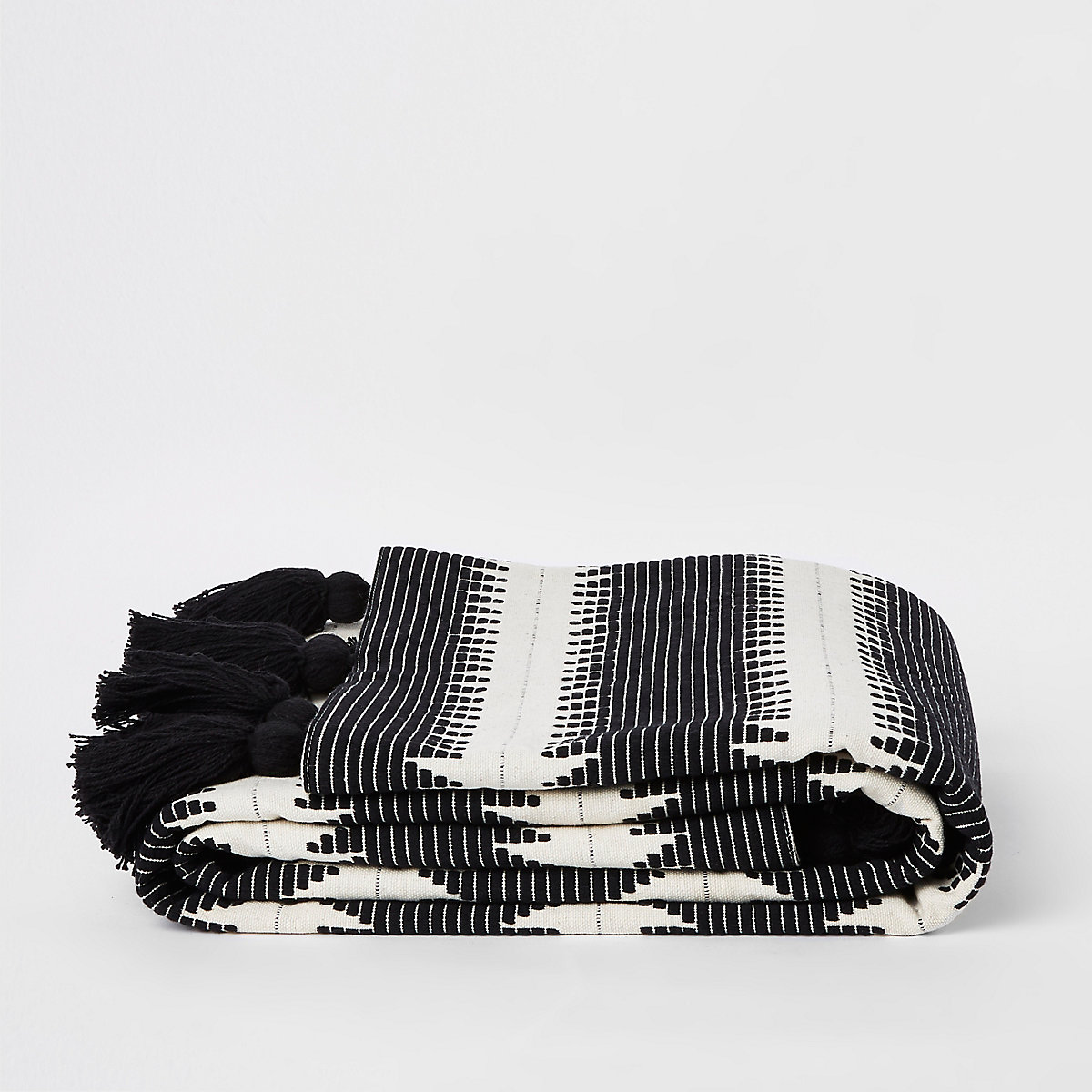 White and black zig zag throw with tassels