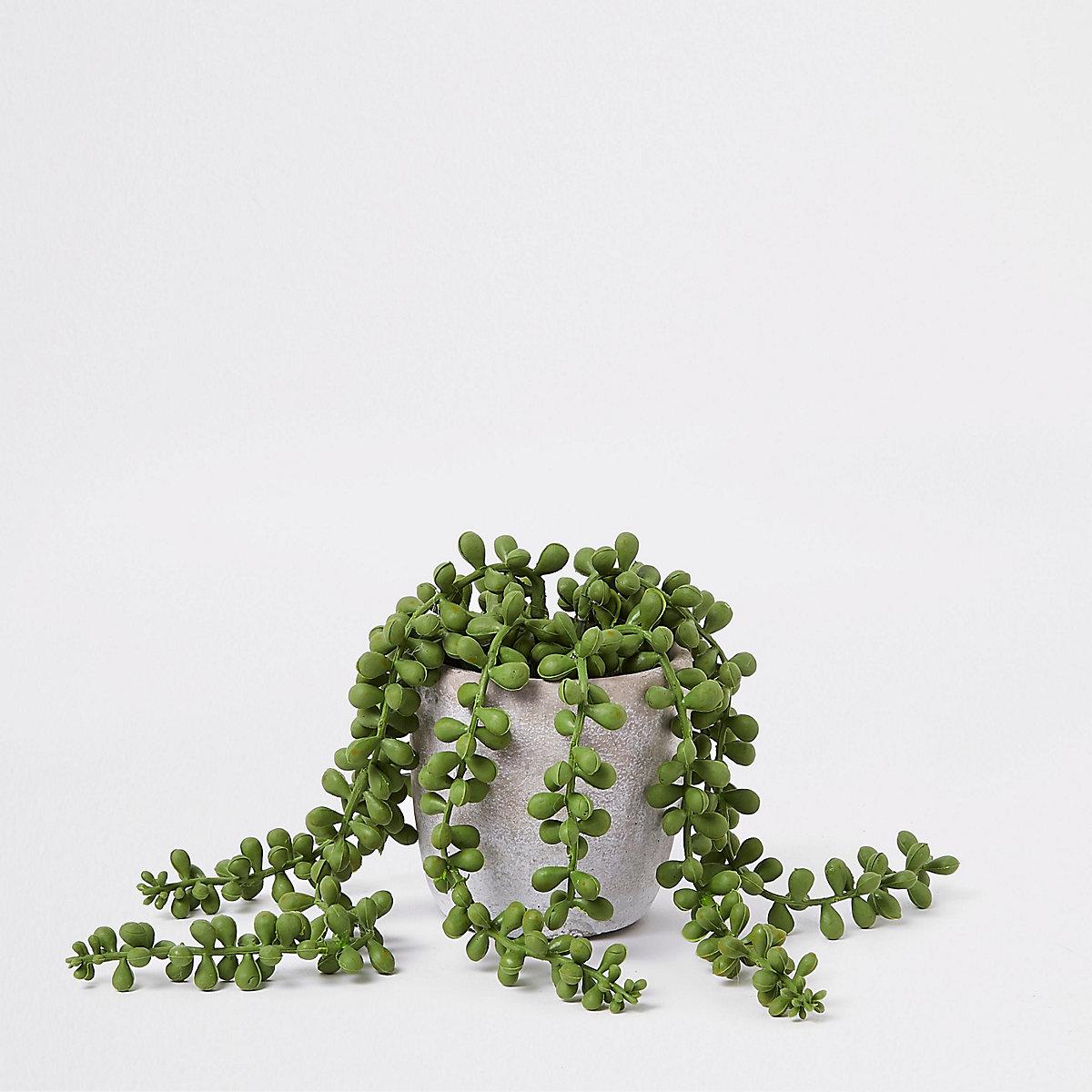 Grey overflowing artificial succulent pot